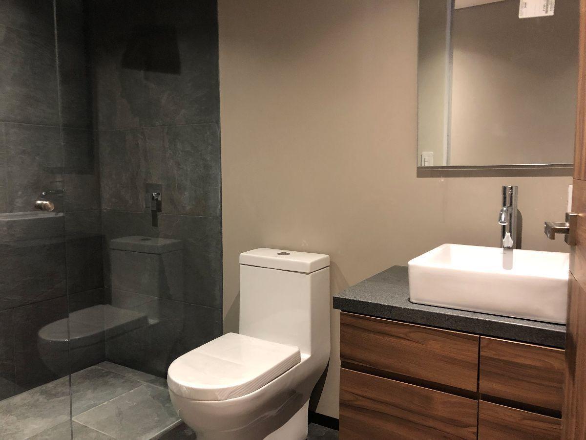 12 de 16: Foto del baño principal en una de las recámaras