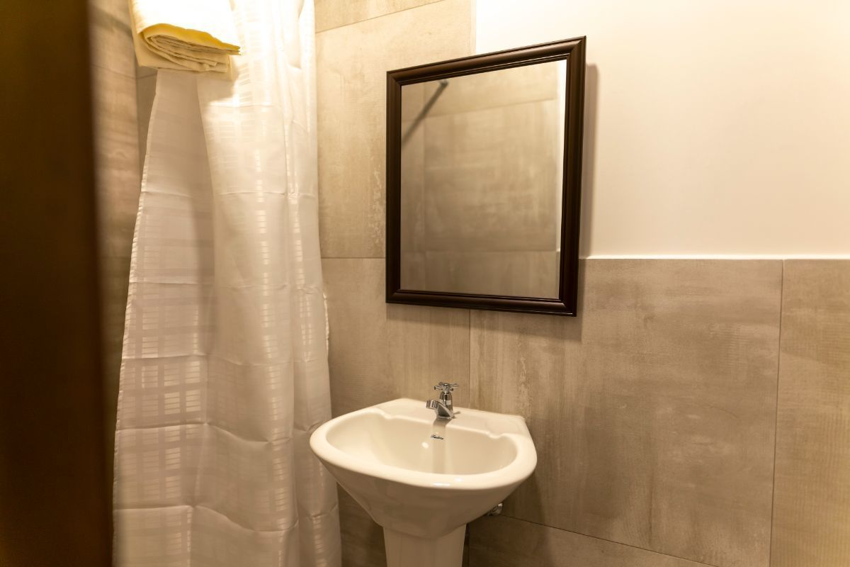 11 de 50: baño de servicio