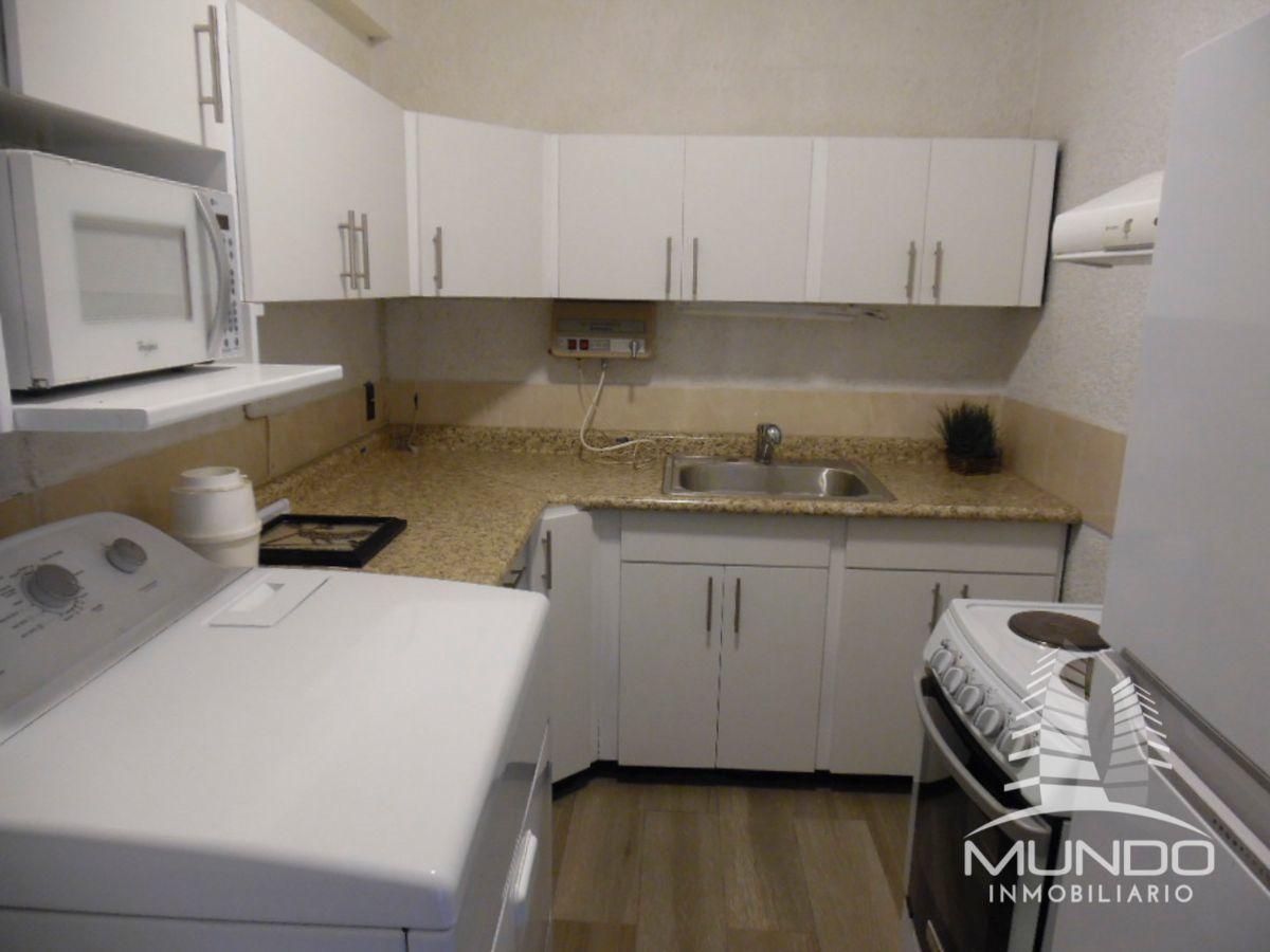 3 de 9: Cocina equipada y lavanderia