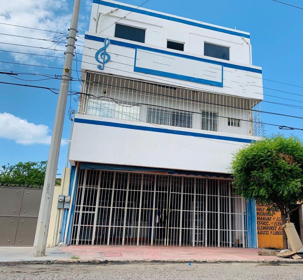3 de 11: EDIFICIO DE TRES PISOS