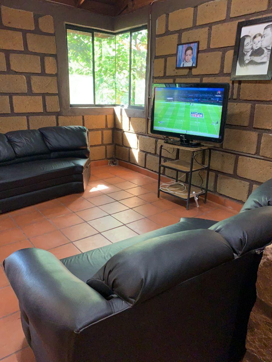 17 de 22: Sala de TV Casa Sillar