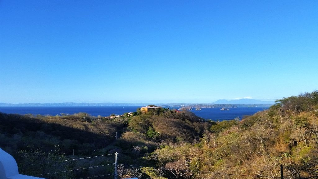 13 of 16: View of ocean and volcanoes