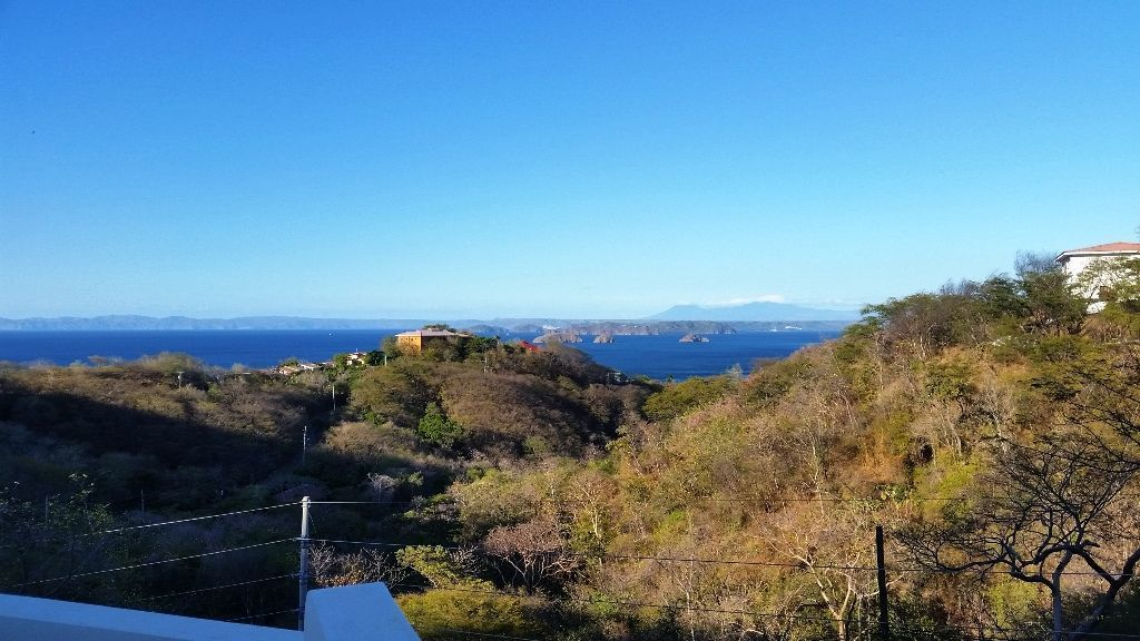 14 of 16: View of ocean and volcanoes