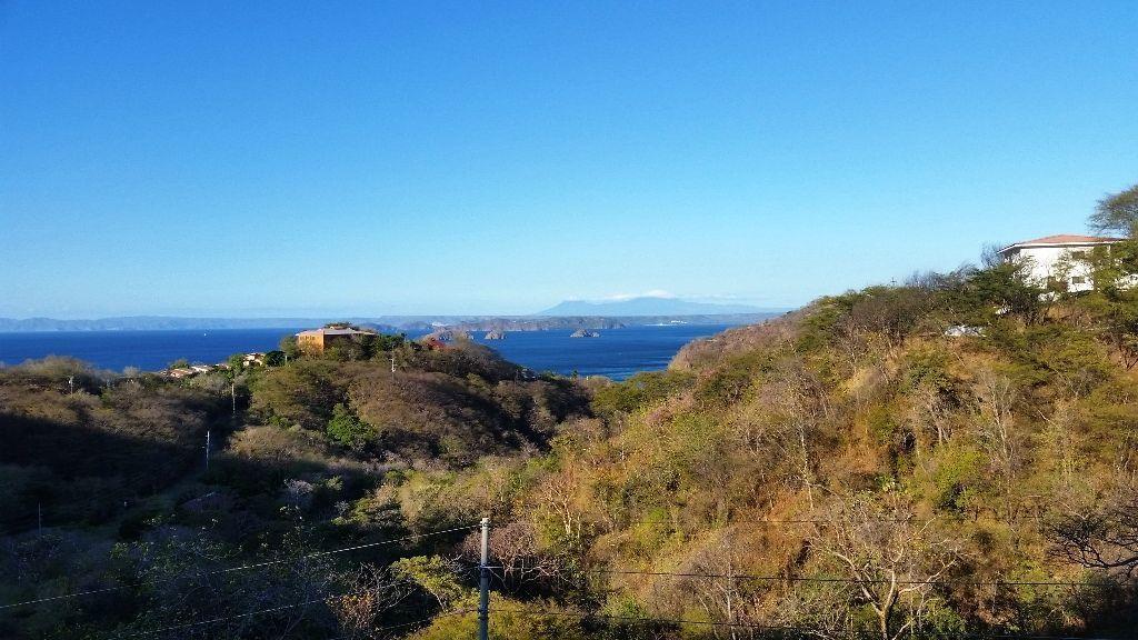 15 of 16: View of ocean and volcanoes