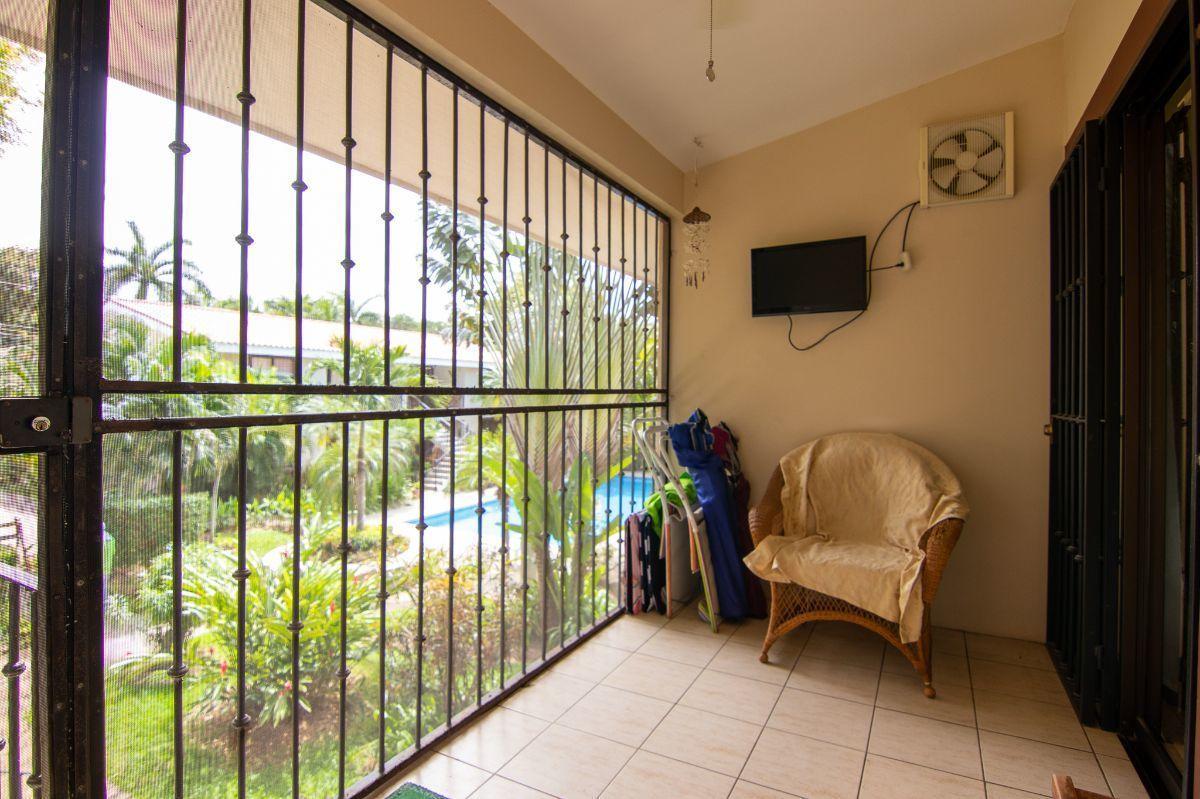 12 of 18: Enclosed balcony