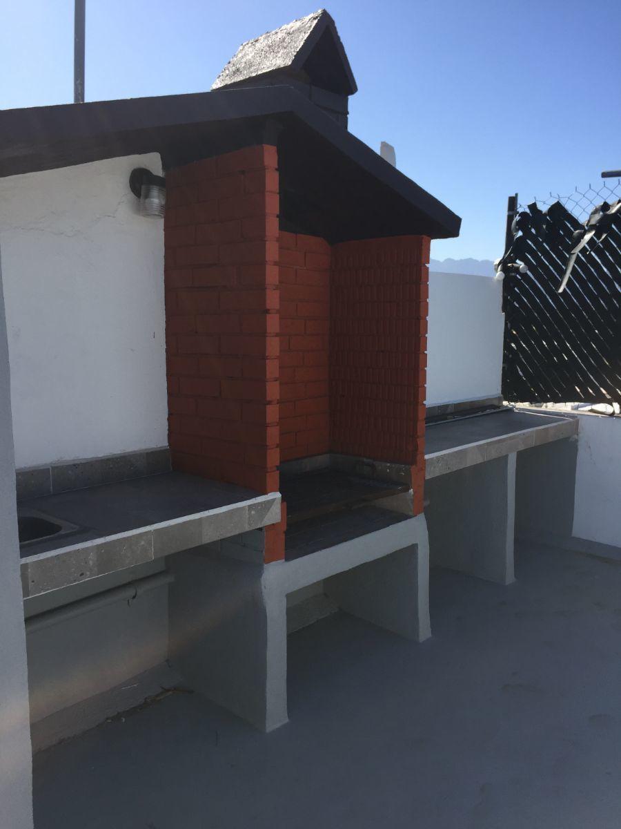 5 de 7: Terraza exclusiva para el inquilino con asador, baño y vista