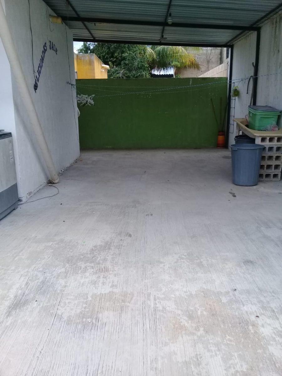 2 de 8: patio techado de la parte trasera de la casa