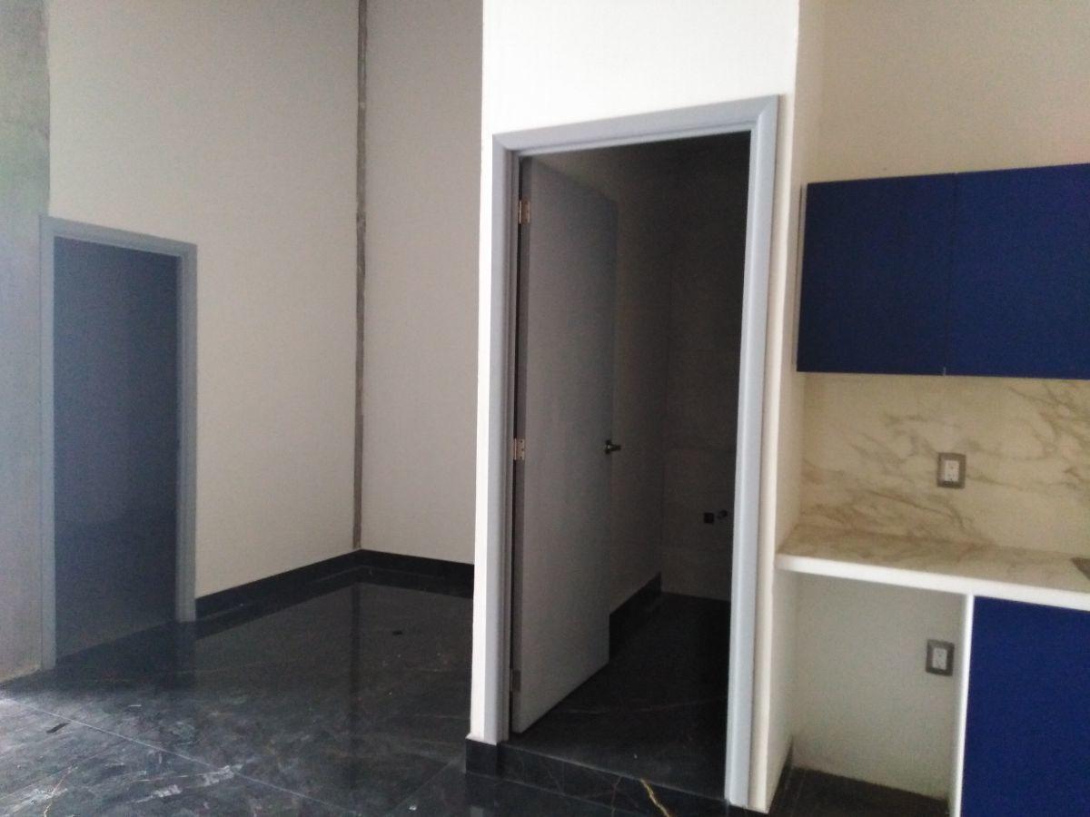 11 de 16: Cocineta/baño/bodega/área de oficina