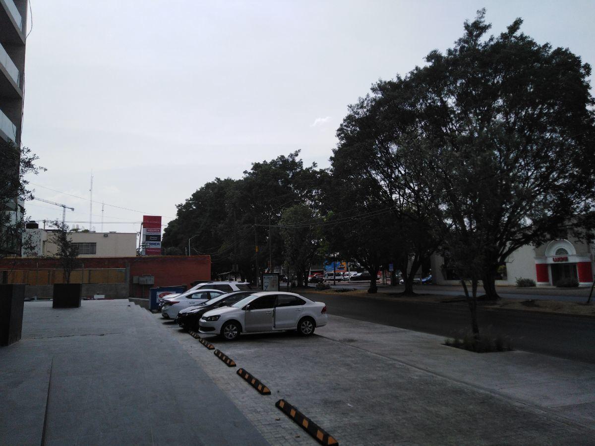 16 de 16: área de estacionamiento sobre Av. Niños Héroes