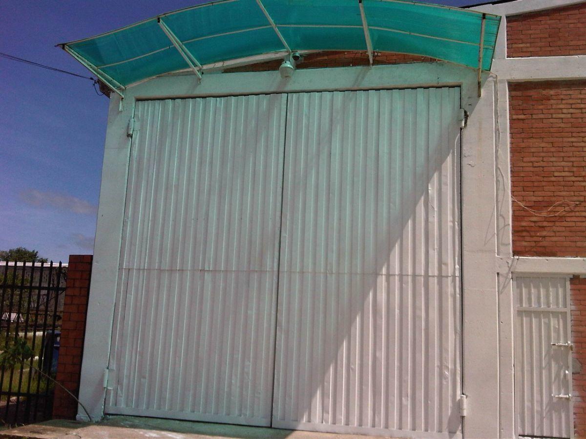 7 de 11: Portón de 6x6m para acceso a trailers