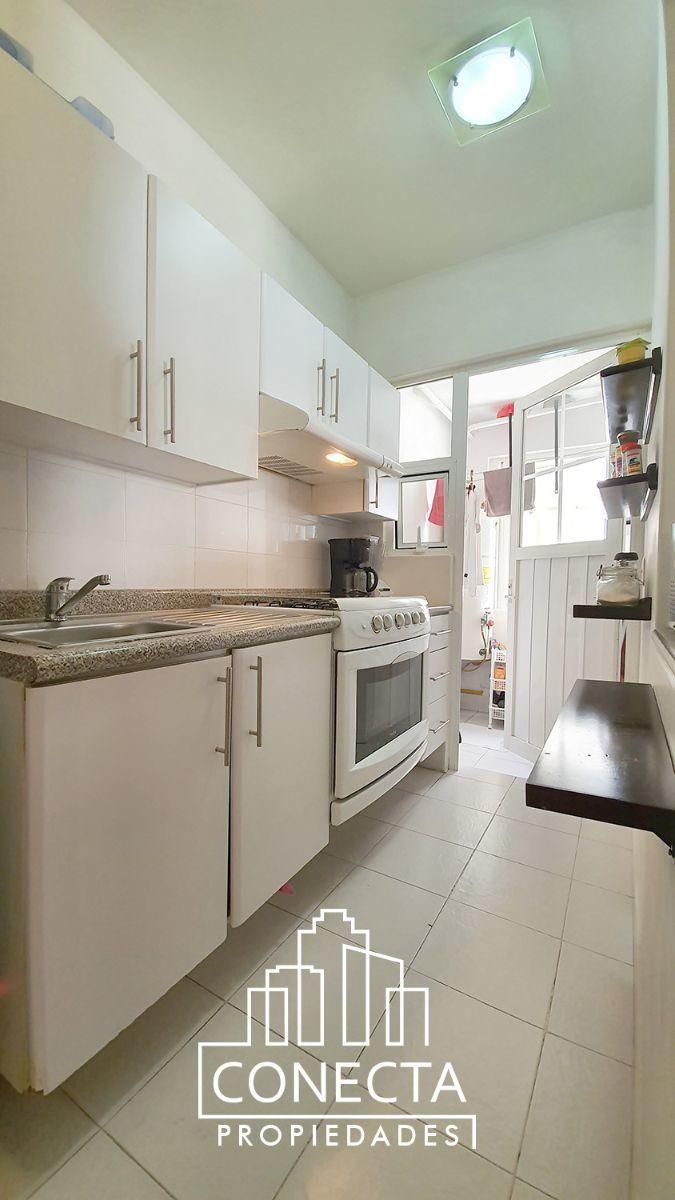 12 de 18: Cocina con area de lavado