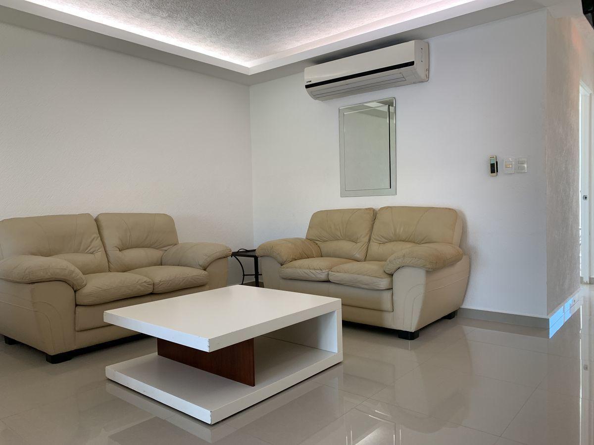 3 de 9: Tanto el comedor como la sala cuentan con aire acondicionado