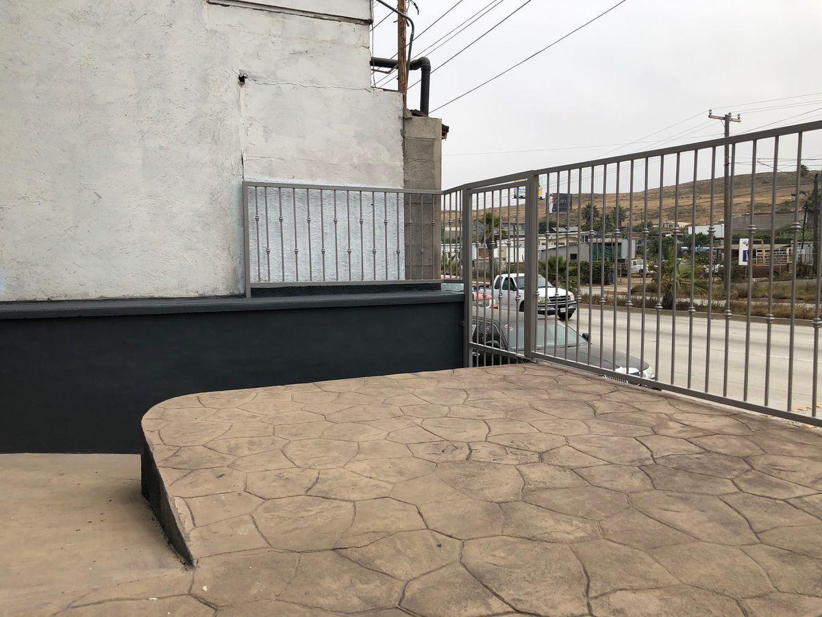 13 de 40: Terraza y rampa de acceso a sillas de ruedas