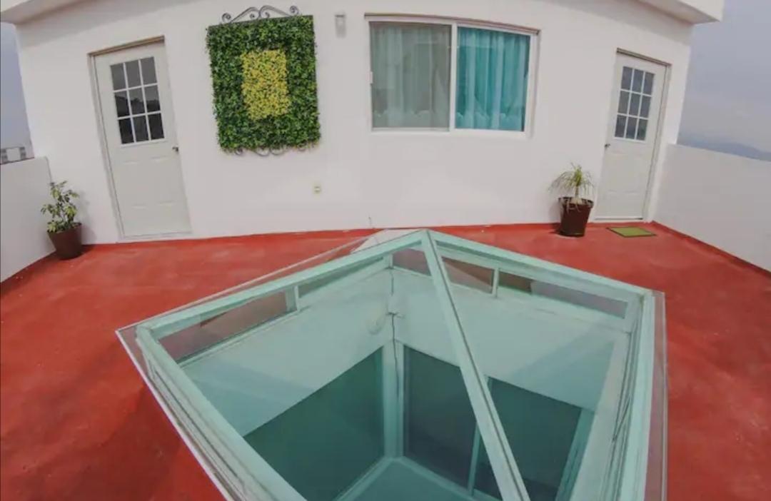 12 de 13: acceso a roof garden con vista panorámica