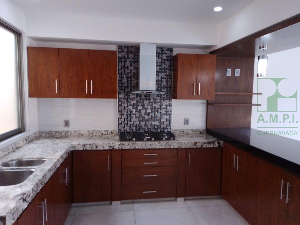 33 de 36: Cocina con acabados de granito comedor  sala luz ambiente