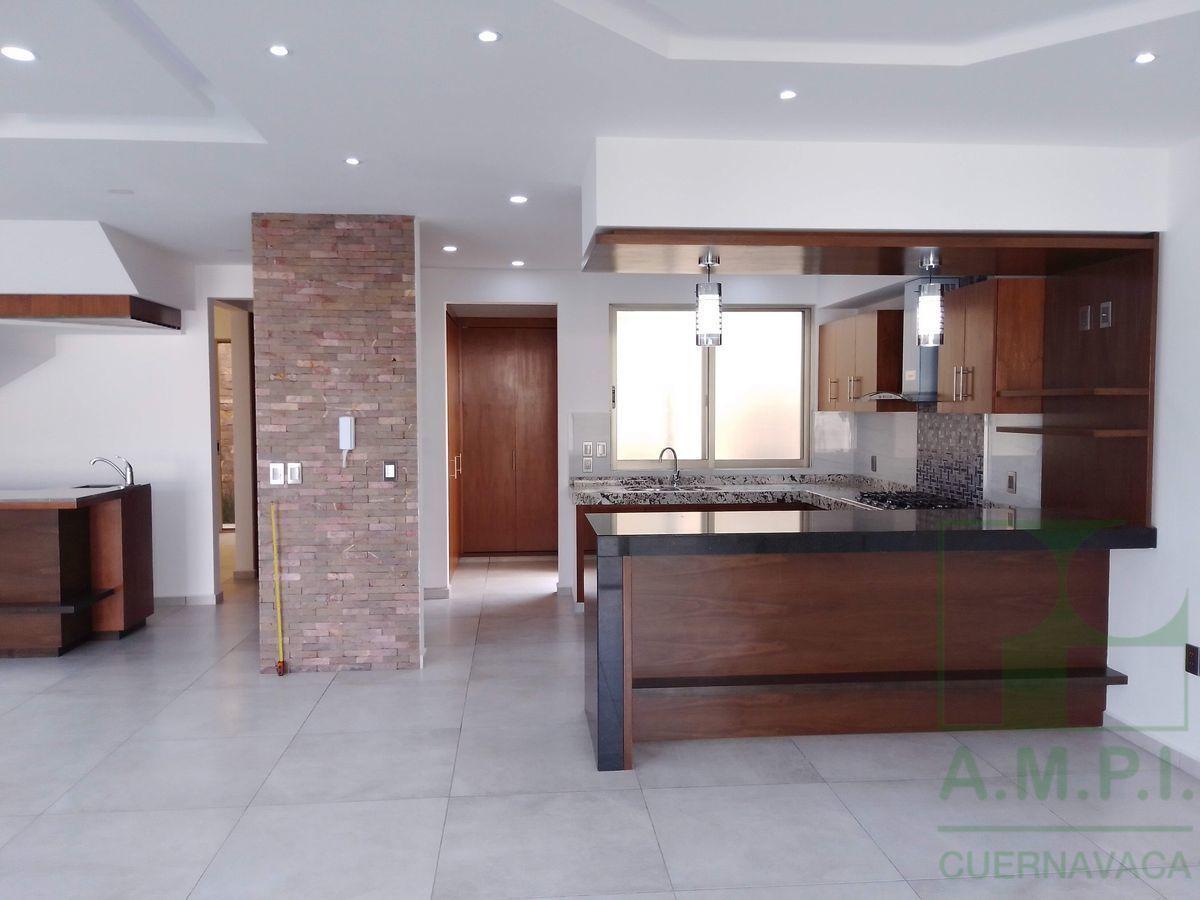 34 de 36: Cocina con acabados de granito comedor  sala luz ambiente