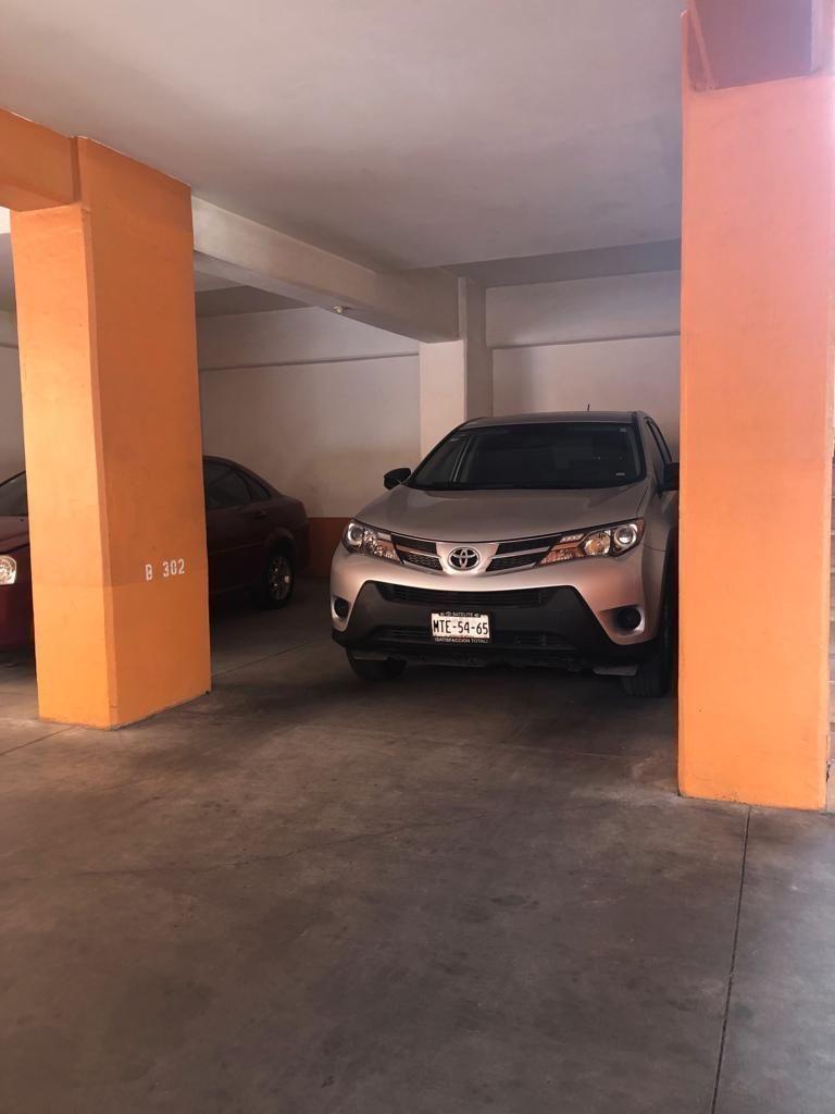 19 de 31: Estacionamiento
