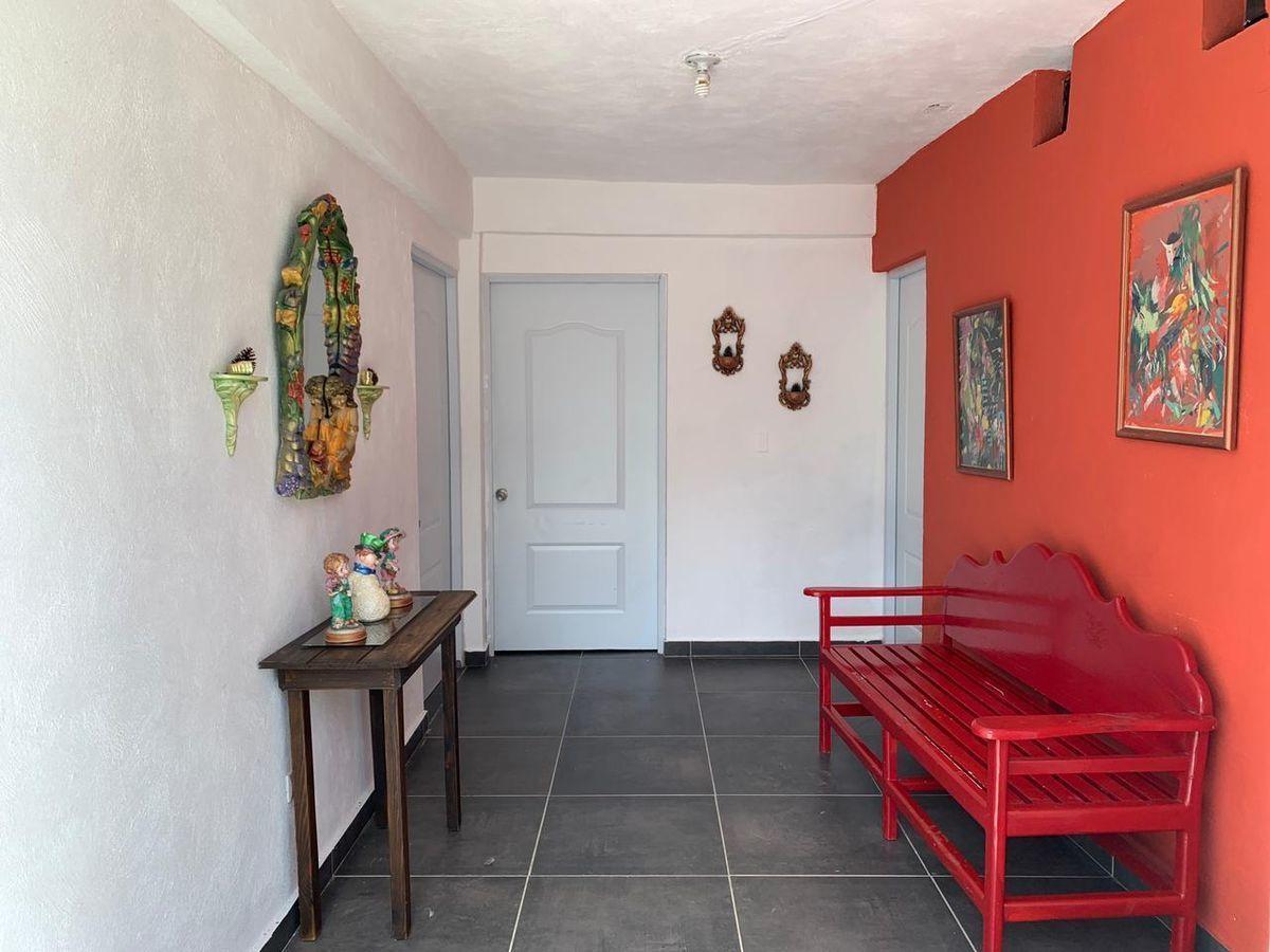 4 de 12: entrada a habitaciones exterior