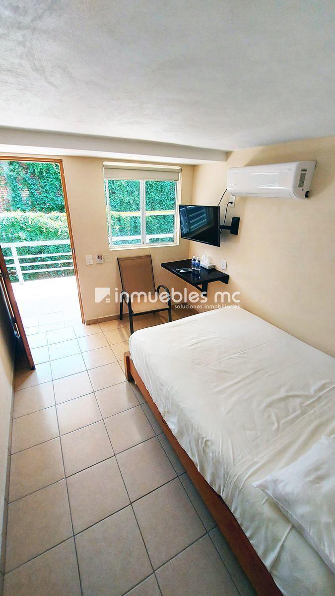 15 de 34: Habitación doble con aire acondicionado