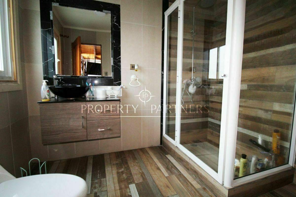 11 de 17: Baño en suite