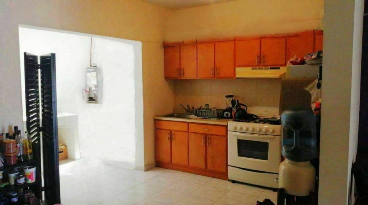 6 de 22: Lavanderia y cocina juntas para comodidad y conveniencia.