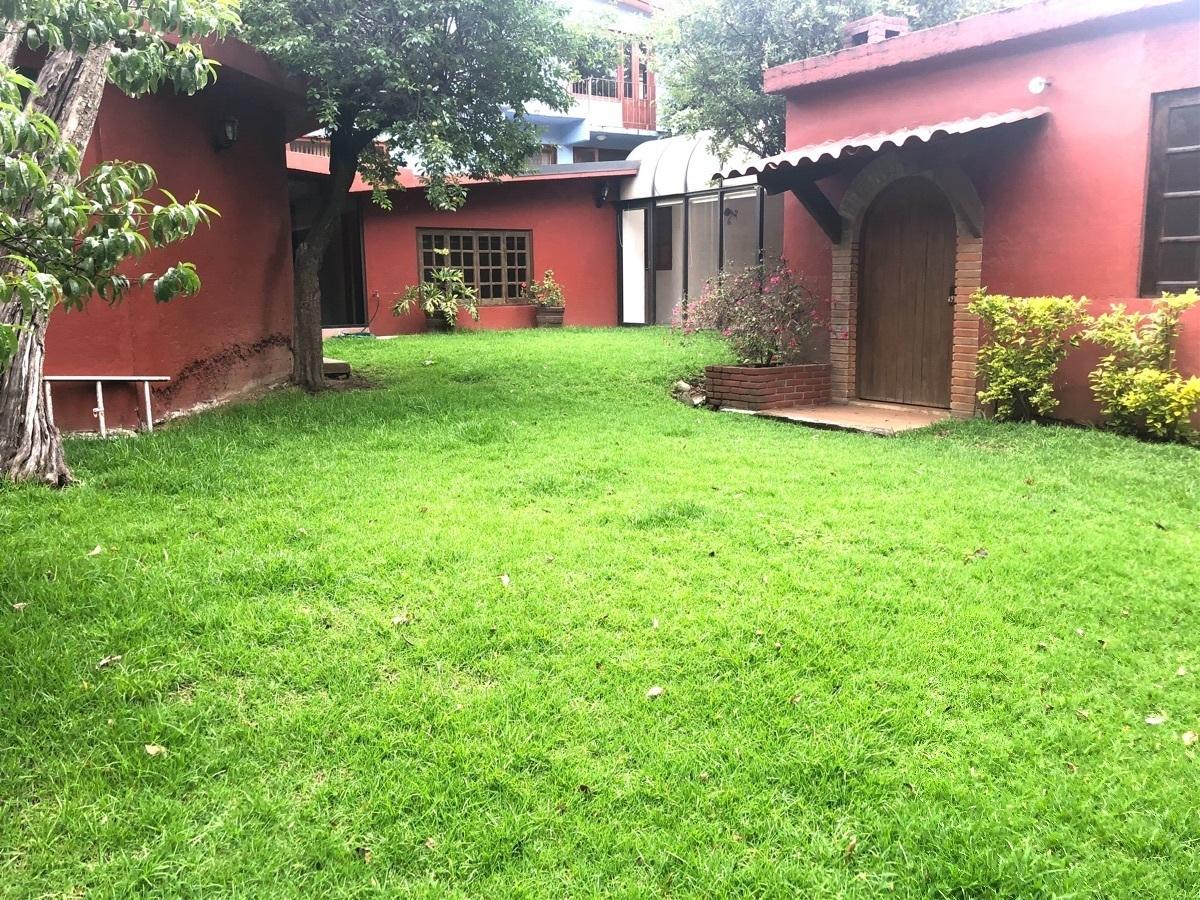 32 de 38: Jardin trasero