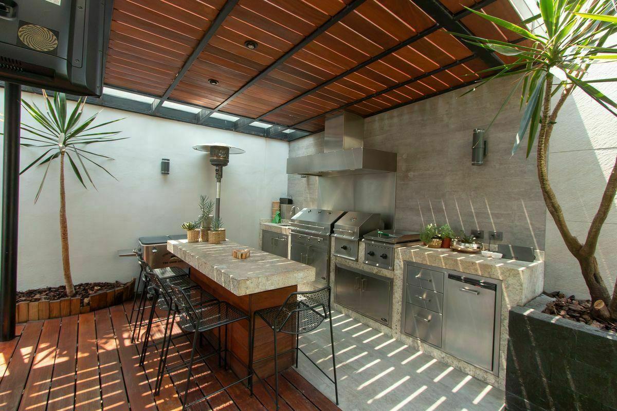 18 de 20: Terraza exterior, barra y asador