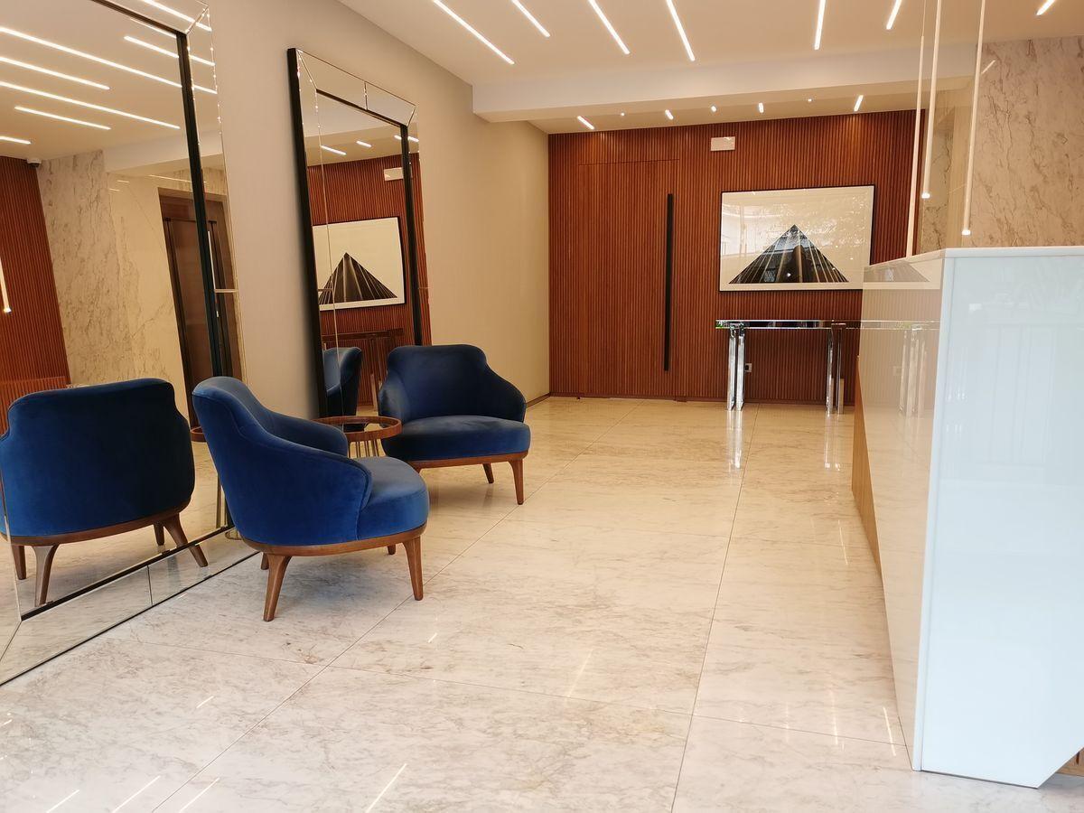 8 de 23: Moderno y a la vez elegante Lobby del edificio