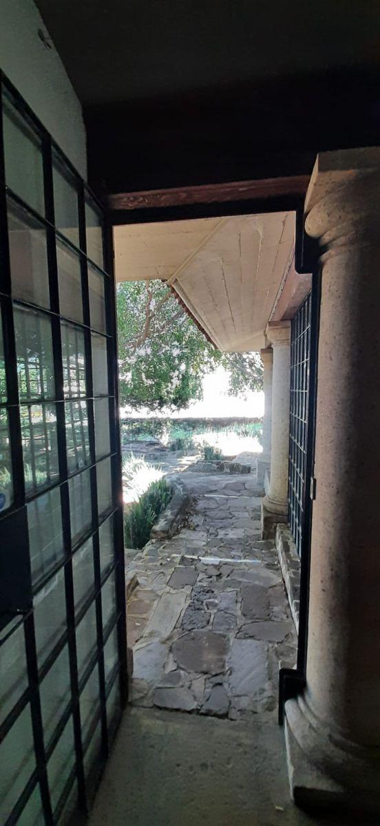 20 de 33: Salida a Jardin Lateral