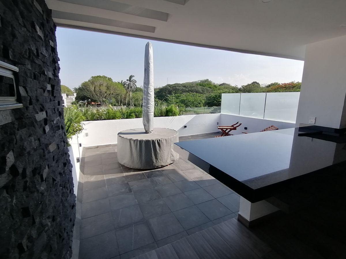14 de 18: Roof Garden con terraza, barra de granito, asador y 1/2 baño