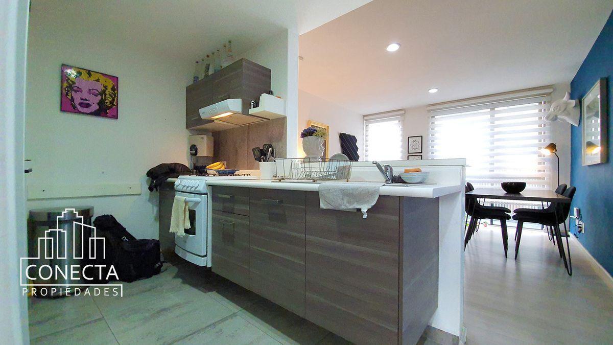 3 de 20: Cocina con barra y area de lavado independiente