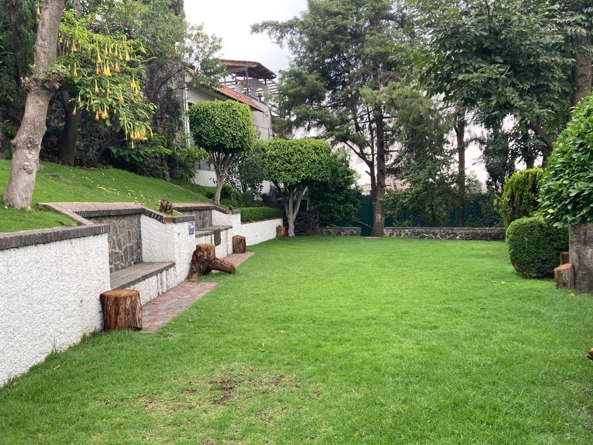 18 de 19: Jardín común con asador