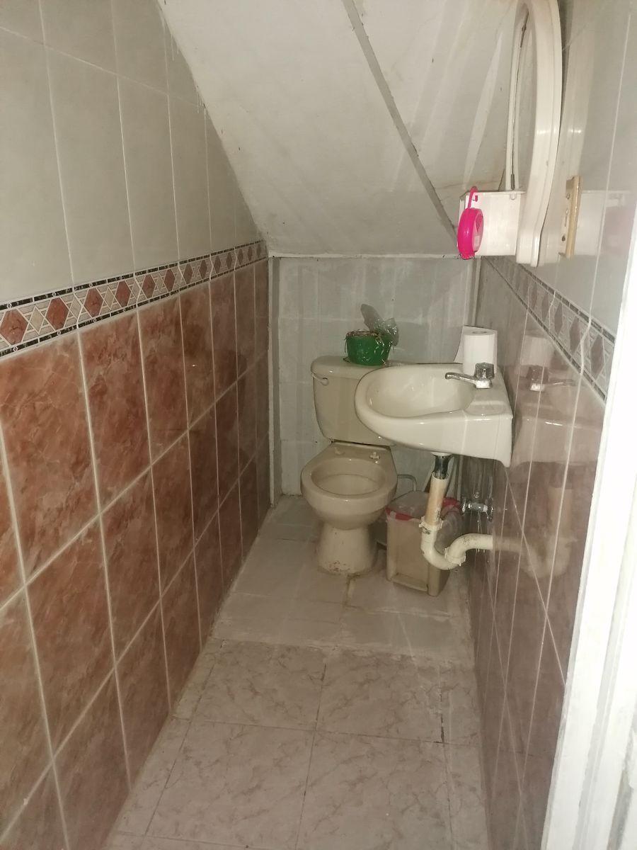 30 de 40: baño de visita