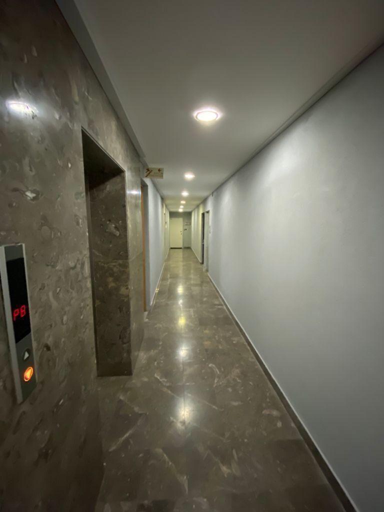 8 de 11: Pasillo/elevador
