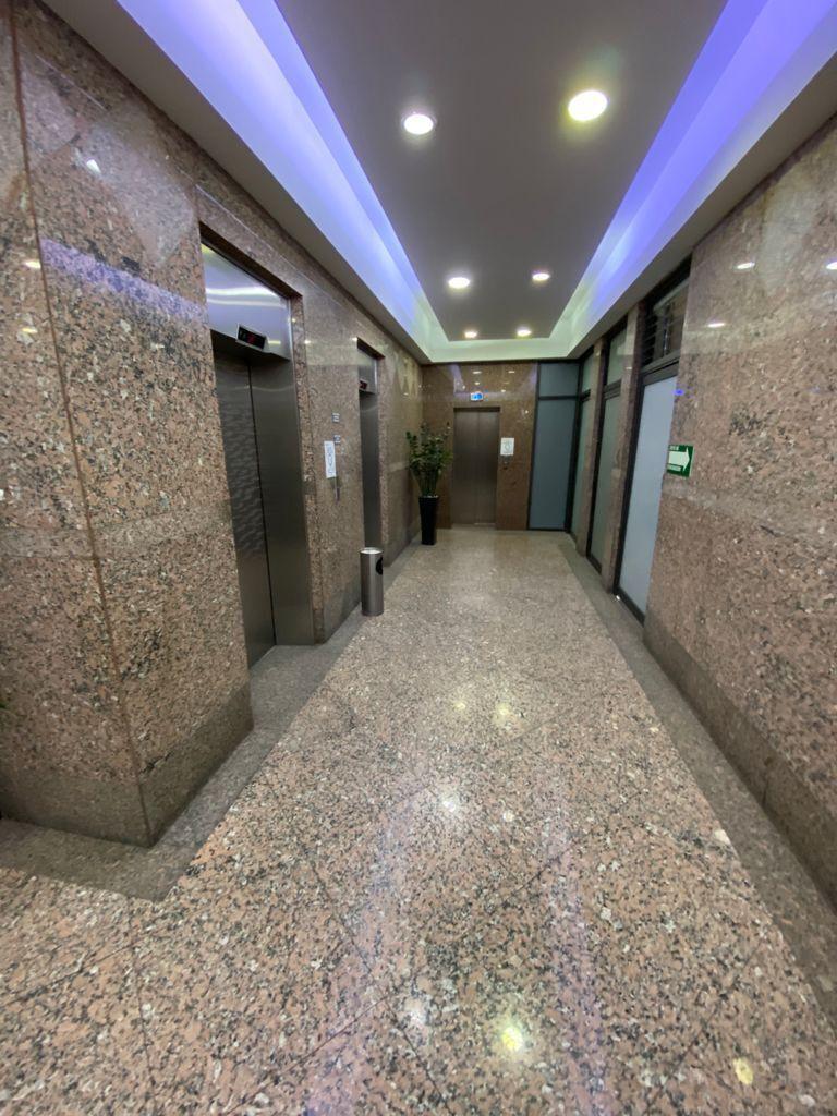9 de 11: Pasillo/elevador