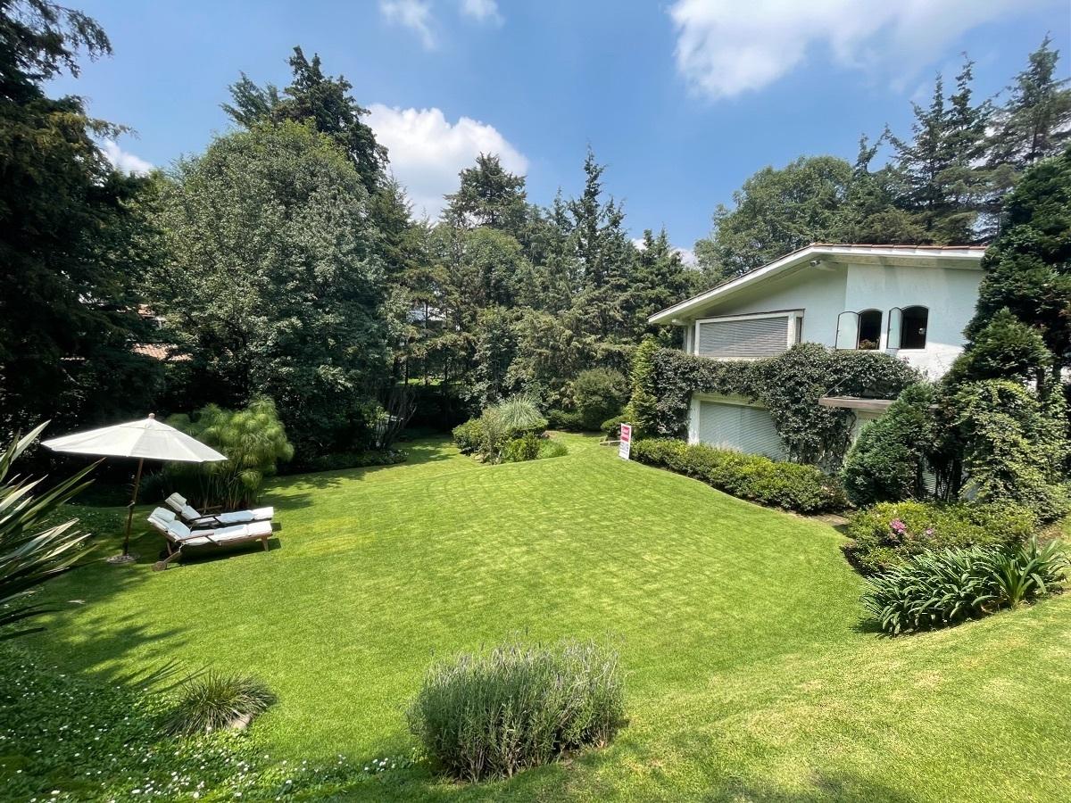 4 de 24: Terraza que se integra al family y a su vez al jardín