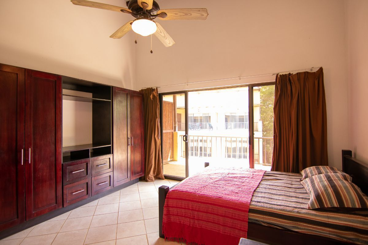 9 of 19: Master bedroom with private balcony