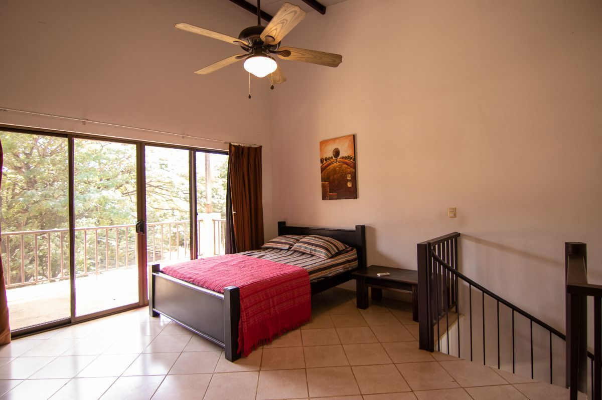 10 of 19: Master bedroom with private balcony