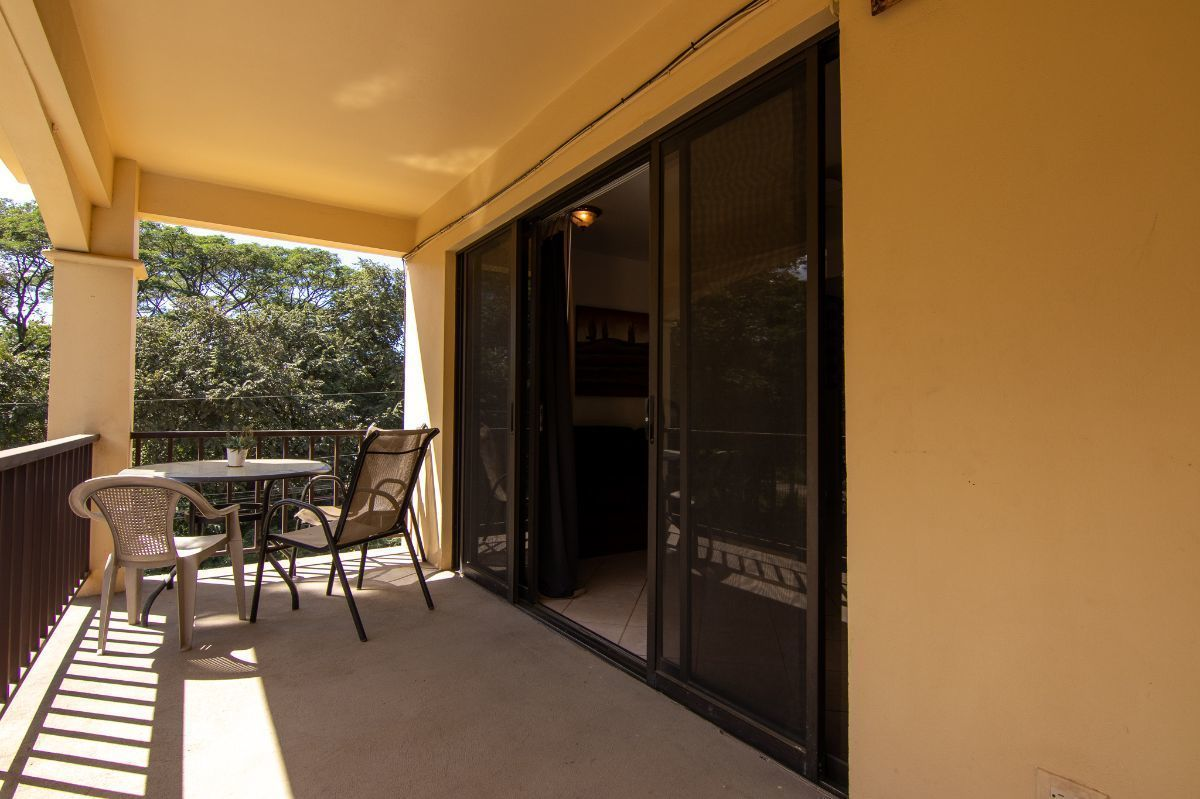 3 of 19: Front of the condo with private balcony