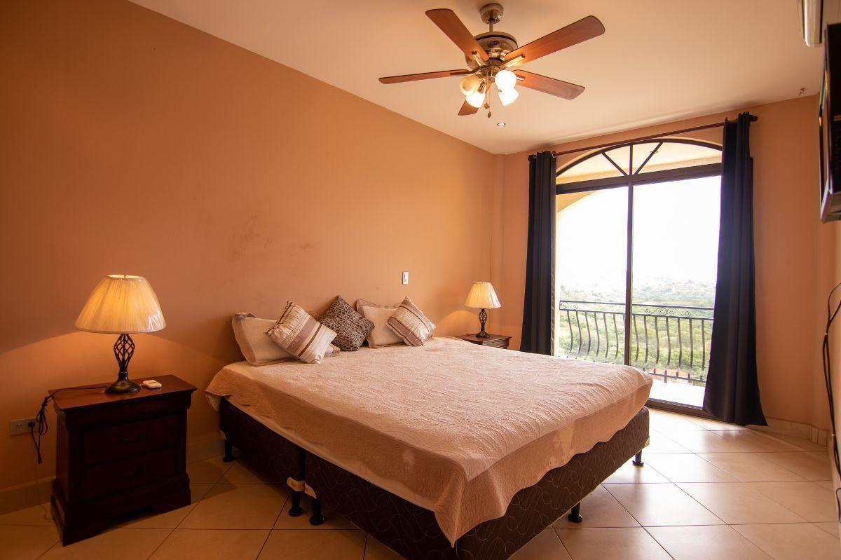 7 of 9: Ocean view master bedroom