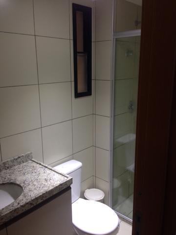 12 de 18: banheiro com box