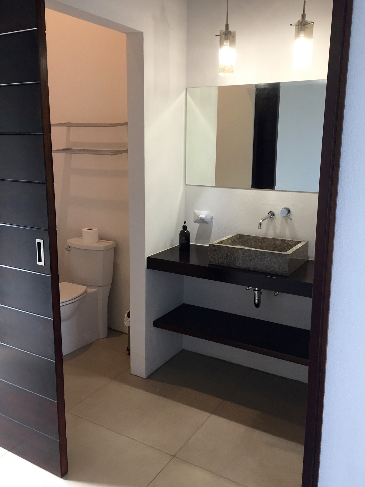 9 of 44: Shared guest bathroom.
