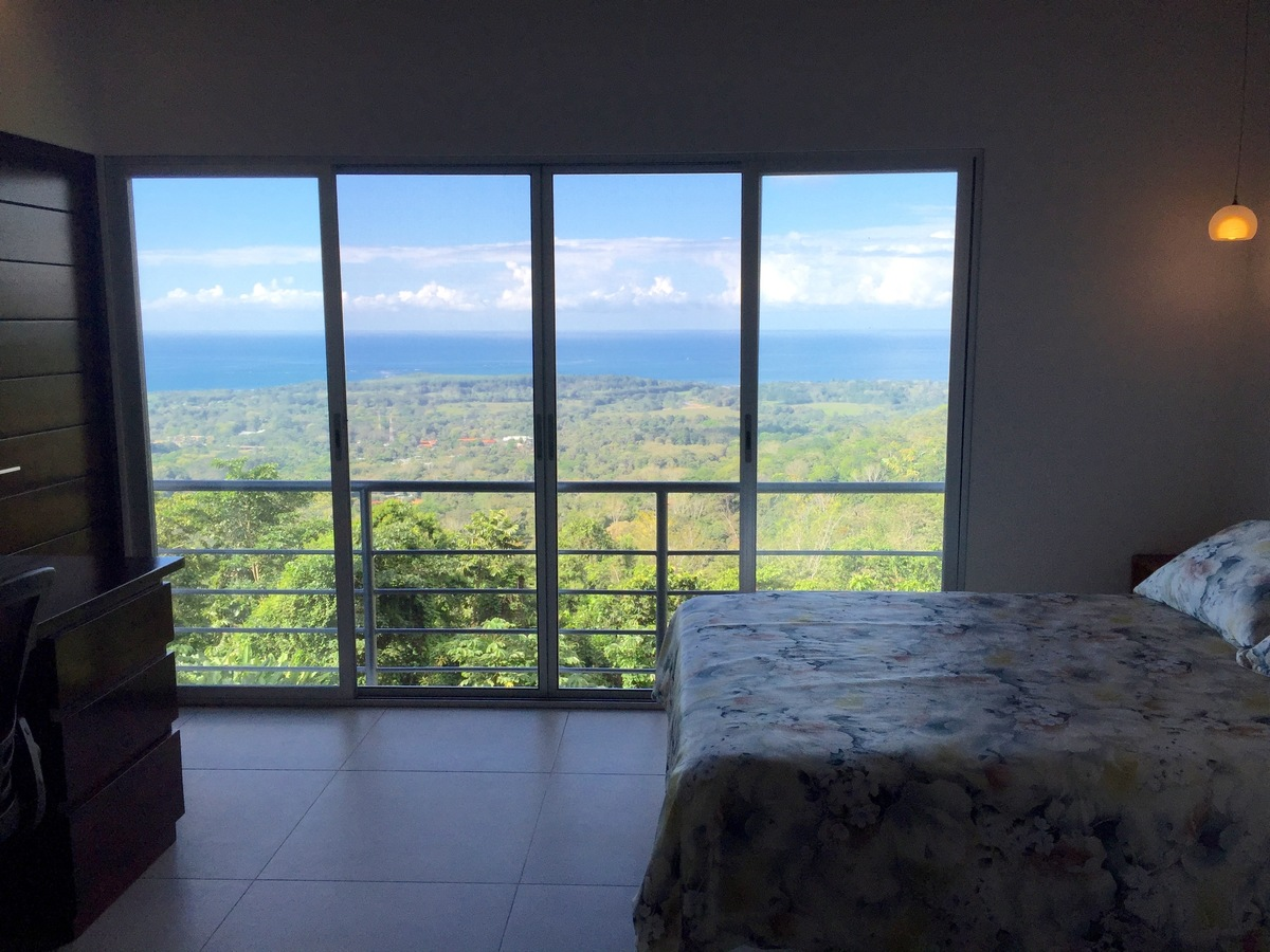 7 of 44: Guest bedroom with fantastic ocean views.