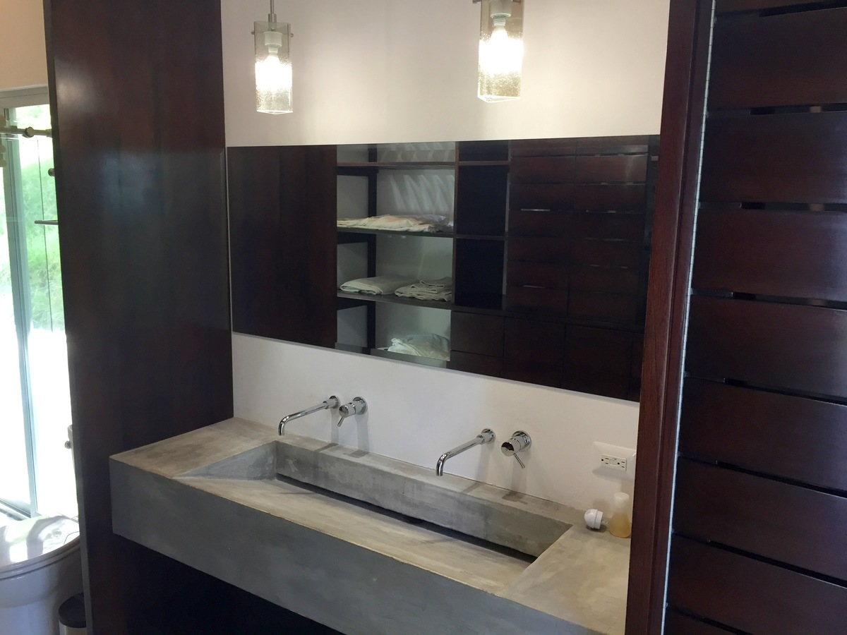 6 of 44: Double sink, built in storage, and large shower.