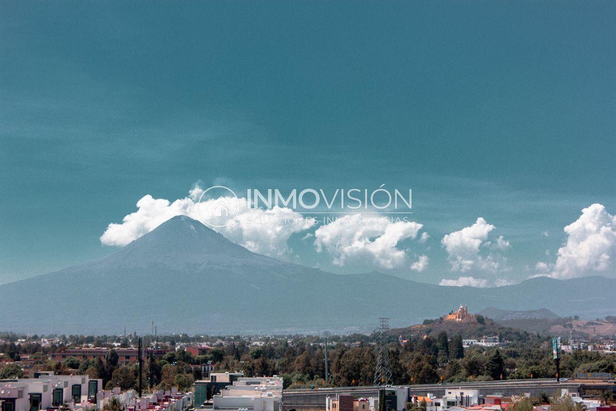 20 de 24: Vista a volcanes y pirámide/iglesia de Cholula