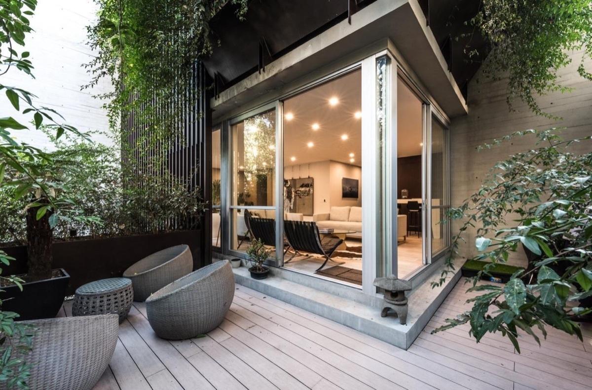 1 de 13: Terraza que se integra al jardín